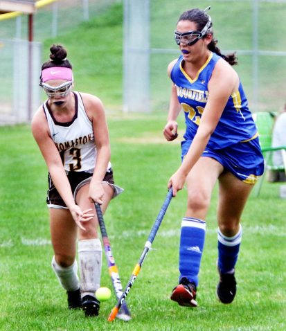 #13 Hannah Laone of Thomaston and #26 Christa Piccorelli battle for the ball during field hockey action in Thomaston Monday. Steven Valenti Republican-American