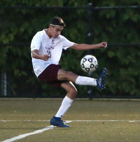Sacred Heart High School's Nicholas Turner kicks the ball up the field during the boys varsity soccer game in Waterbury against Kennedy High School on Tuesday. Emily J. Reynolds. Republican-American