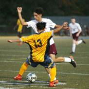 Sacred Heart High School's Gabriel Melo tries to dribble past Kennedy High School's Sher Htoo during the boys varsity soccer game in Waterbury on Tuesday. Emily J. Reynolds. Republican-American