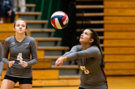 Naugatuck's Shannon Burns #5 sets the ball as her teammate Hailey Russell #4 looks on during a NVL Volleyball match between Naugatuck and Wilby at Wilby High School in Waterbury on Thursday. Bill Shettle Republican-American