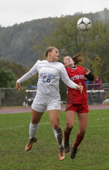 Lewis Mills' Makayla Issakhani #26 and Northwestern's Jane Martin (#3) jump for position on the ball during Berkshire League action at Northwestern Regional High School Saturday morning. Lewis Mills defeated Northwestern 5-0. Michael Kabelka / Republican-American