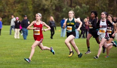 Wolcott's Kathryn Rodrigues, left, takes an early lead in front of Holy Cross' Galvin Brayton and Naugatuck's Julia Kropo at the start of the NVL Cross Country championships held Wednesday at Veterans Memorial Park in Watertown. Jim Shannon Republican American