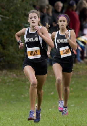 Woodland's Emma Slavin and Jaden Young make their way to the finish line during the NVL Cross Country championships held Wednesday at Veterans Memorial Park in Watertown. Jim Shannon Republican American