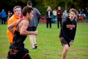 Robert Mitchell and Noah Randy, both members of the Watertown JV cross country team, cheer on one of their varsity teammates during the NVL Cross Country championships held Wednesday at Veterans Memorial Park in Watertown. Jim Shannon Republican American