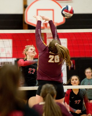 Cheshire's Emily Russolillo (27) spikes the ball past Sheehan's Caitlyn Hunt (26) during their volleyball match with Sheehan Tuesday at Cheshire High School. Jim Shannon Republican American