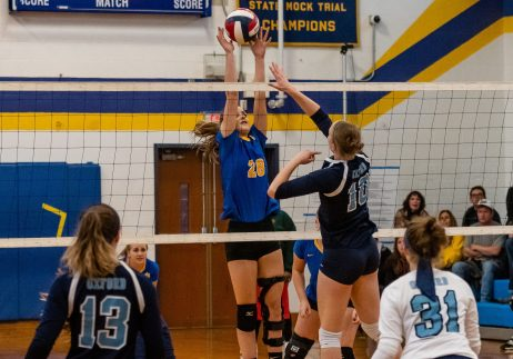 Seymour's Cathryn Ragaini #20 blocks the spike of Oxford's Carly Alton #10 during a girls NVL Quarterfinal match between Oxford and Seymour at Seymour High School in Seymour on Saturday. Seymour beat Oxford and advances to the NVL Semis. Bill Shettle Republican-American