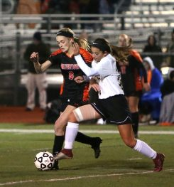 Woodland Regional High School's Julia Accetura and Watertown High School's Madeline Daigneault battle for the ball during the NVL Girls' Soccer Tournament semi-final girls varsity soccer game in Watertown on Tuesday. Emily J. Reynolds. Republican-American