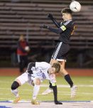 Watertown's (23)Anthony Longo (23) heads the ball in front of St. Paul's Adam Van Linter (12) during their NVL boys soccer semi-final game Tuesday at Crosby High School. Jim Shannon Republican American