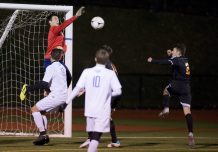 St. Paul's goal keeper Jack Noli knocks away a shot during their NVL boys soccer semi-final game against Watertown Tuesday at Crosby High School. Jim Shannon Republican American