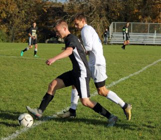 Woodland's Maciej Lewicki (5) pushes the ball up the field ahead of Seymour's Vadyn Sokhan (7) during a Naugatuck Valley League tournament quarterfinal match Monday at Woodland Regional High School in Beacon Falls. (Elio Gugliotti / Citizen's News)