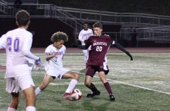 Crosby's Anthony Orellano (7) controls the ball in front of Naugatuck's Jay Barth (20) during a Naugatuck Valley League quarterfinal match Monday at Naugatuck High School. (Elio Gugliotti / Citizen's News)