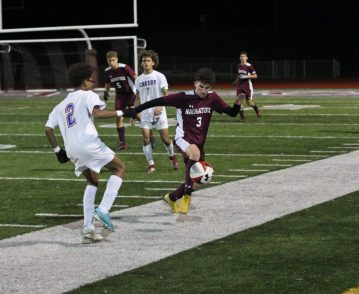 Naugatuck's Freddie Longo (3) plays the ball on a throw-in in front of Crosby's Eurico Gomes-Boaventura (2) during a Naugatuck Valley League tournament quarterfinal match Monday at Naugatuck High School. (Elio Gugliotti / Citizen's News)