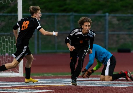 Watertown's Troy Tedesco #9 celebrates as does his teammate Jake Champagne #18 after his scoring of a goal in the first half during the boys NVL Championship game between Watertown and Woodland Regional at Naugatuck High School in Naugatuck on Thursday. Bill Shettle Republican-American