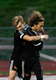 Watertown's Jake Champagne #18 hugs teammate Troy Tedesco #9 in celebration after scoring a goal in the first half during the boys NVL Championship game between Watertown and Woodland Regional at Naugatuck High School in Naugatuck on Thursday. Bill Shettle Republican-American