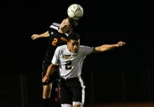 Watertown's Zack Fenn #2 heads the ball over Woodland's Jason Claiborn #2 during the boys NVL Championship game between Watertown and Woodland Regional at Naugatuck High School in Naugatuck on Thursday. Bill Shettle Republican-American