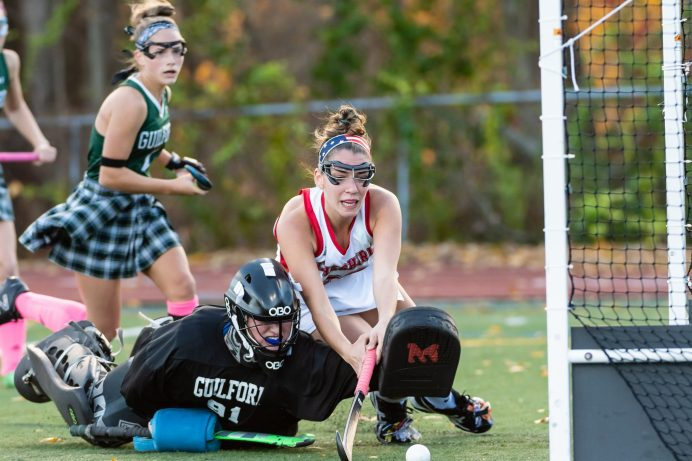 Cheshire's Kayla Sansone #28 dives over Guilford goalkeeper Eve Young #91 knocking the ball in for a goal to tie the score at 1-1 during the SCC Championship game between Cheshire and Guilford at Guilford High School in Guilford on Saturday. Guilford comeback immediately scoring two goals to win 3-1, winning the SCC Title. Bill Shettle Republican-American