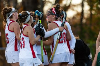 Cheshire's Kayla Sansone #28, right, celebrates with her teammates, Olivia Salmon #33, Sophie Cremo #5, and others after scoring a goal to tie the game during the SCC Championship game between Cheshire and Guilford at Guilford High School in Guilford on Saturday. Guilford scored two unanswered goals, after Cheshire tied it up to win 3-1, winning the SCC Title. Bill Shettle Republican-American