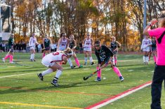 Cheshire's Mikayla Crowley #3 shoots the ball on goal through the legs of Guilford's Catherine Larrow #26 during the SCC Championship game between Cheshire and Guilford at Guilford High School in Guilford on Saturday. Guilford scored two unanswered goals, after Cheshire tied it up to win 3-1, winning the SCC Title. Bill Shettle Republican-American