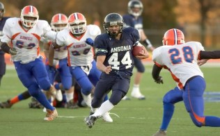 2006: Ansonia's Alex Thomas looks to run past Bloomfield's Josh Broaden (28) on his way for a 39-yard touchdown run during their 34-12 win in the Class S finals Saturday at Jess Dow Field on the SCSU campus in New Haven. Thomas finished with 257 yards and three touchdowns. (RA)