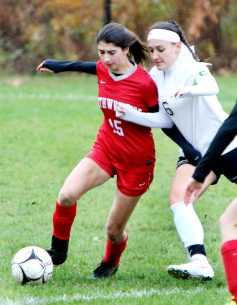#15 Sydney Dzenutis of Northwestern and #6 Juliana Villano of Woodland battle for the ball during CIAC Class M girls soccer tournament action in Winsted Monday. Steven Valenti Republican-American