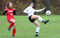 #5 Julia Casimiro of Woodland sends a ball down field as #16 Emma Cameron of Northwestern defends during CIAC Class M girls soccer tournament action in Winsted Monday. Steven Valenti Republican-American