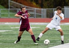 Naugatuck's Alex Manasoiu #15 and Newtown's Henry Scott Vaughan #4 battle for control of the ball during the first round of the CIAC Class LL boys' soccer tournament between #22 Newtown and #11 Naugatuck at Naugatuck High School in Naugatuck on Tuesday. Naugatuck beat Newtown 1-0 and advances to the next round on Thursday. Bill Shettle Republican-American