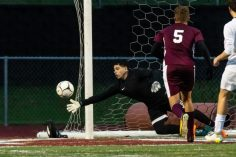 Naugatuck's goalkeeper Brandon Sampaio #0 dives to his right making a save to preserve his shutout during the first round of the CIAC Class LL boys' soccer tournament between #22 Newtown and #11 Naugatuck at Naugatuck High School in Naugatuck on Tuesday. Naugatuck beat Newtown 1-0 and advances to the next round on Thursday. Bill Shettle Republican-American