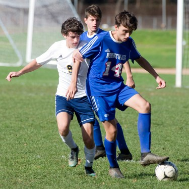 Nonnewaug's Aiden Colby (14) fights off Haddam-Killingsworth's Niko Yepes (9) while trying to control the ball during their Class M tournament game Wednesday at Nonnewaug High School in Woodbury. Jim Shannon Republican American