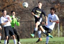 #25 Ethan Carlone of Woodland tries to score off a corner kick against Aerospace during CIAC Class M soccer action in Beacon Falls Wednesday. Steven Valenti Republican-American