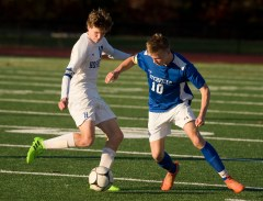 Litchfield's Charlie Shanks (10) and Housatonic's Matthew Lopes (10) battle for the ball during their Class S tournament game Thursday at Torrington High School. Jim Shannon Republican American