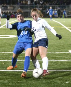 Lewis Mills High School's Abby Mills and Morgan High School's Taylor Maher battle for the ball during the CIAC Class M semifinal girls varsity soccer tournament game on Falcon Field in Meriden on Monday. Emily J. Reynolds. Republican-American