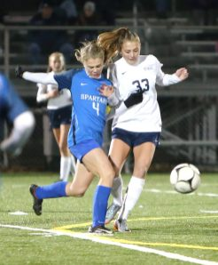 Lewis Mills High School's Morgan Sokol and Morgan High School's Carley Schmidt battle for the ball during the CIAC Class M semifinal girls varsity soccer tournament game on Falcon Field in Meriden on Monday. Emily J. Reynolds. Republican-American