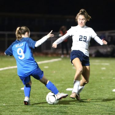 Lewis Mills High School's Caitlin Angers and Morgan High School's Jessica Flanagan battle for the ball during the CIAC Class M semifinal girls varsity soccer tournament game on Falcon Field in Meriden on Monday. Emily J. Reynolds. Republican-American