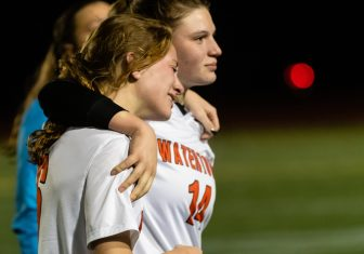 Watertown's Alyssa Santangeli #14 walks off the field with teammate Malina LaCapra #6 after Watertown got beat by Tolland 2-1 in a Girls Soccer Class L Semifinal game between Watertown and Tolland at Veterans Memorial Stadium at Willowbrook Park in New Britain on Monday. Bill Shettle Republican-American