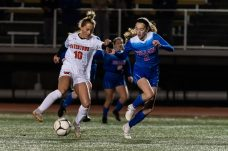 Watertown's Meadow Mancini #10 reverses direction on Tolland's Rachel Lee #2 that led to a breakaway and a goal during a Girls Soccer Class L Semifinal game between Watertown and Tolland at Veterans Memorial Stadium at Willowbrook Park in New Britain on Monday. Bill Shettle Republican-American