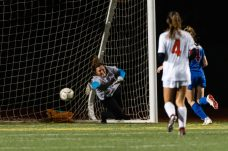 Watertown goalkeeper Emily Deptula #00 dives to her right trying stop a shot, that led to the game winning goal during the Girls Soccer Class L Semifinal game between Watertown and Tolland at Veterans Memorial Stadium at Willowbrook Park in New Britain on Monday. Tolland beat Watertown 2-1 and advances to the Class L finals. Bill Shettle Republican-American