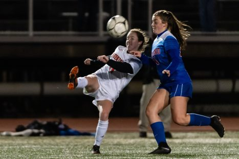 Watertown's Morgan Dodge #11 kicks the ball away from Tolland's Gabby Boivin #21 during the Girls Soccer Class L Semifinal game between Watertown and Tolland at Veterans Memorial Stadium at Willowbrook Park in New Britain on Monday. Bill Shettle Republican-American