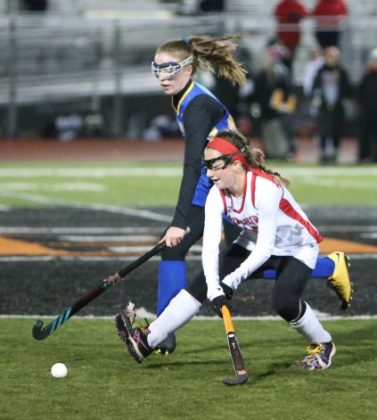 Cheshire High School's Megan Daly battles Newtown High School's Abigayle Tainter for the ball during the Class L semifinal game in Watertown on Tuesday. Emily J. Reynolds. Republican-American