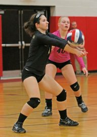 WoodlandÕs Rachel Poulos #4 returns the ball against Seymour as May Dawes #40 looks on in Class M semi-final Volleyball tournament at Pomperaug High School Tuesday night. Seymour won 3-0. Michael Kabelka / Republican-American.