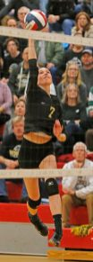 Woodland's Stephanie Krebbs #7 returns the ball against Seymour in Class M semi-final Volleyball tournament at Pomperaug High School Tuesday night. Seymour won 3-0. Michael Kabelka / Republican-American.