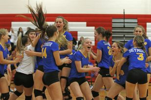 Seymour celebrates after defeating Woodland in Class M semi-final Volleyball tournament at Pomperaug High School Tuesday night. Seymour won 3-0. Michael Kabelka / Republican-American.