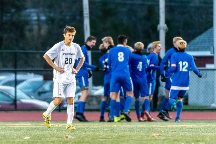 Pomperaug's Matthew Karp #20 reacts dissappointed while the Glastonbury team celebrates after scoring a goal during a Boys Soccer Class L Semifinal game between Glastonbury and Pomperaug at Veterans Memorial Stadium at Willowbrook Park in New Britain on Wednesday. Bill Shettle Republican-American