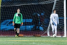 Pomperaug goalkeeper Nathan Barstrom #1 reacts by looking to the sky as Pomperaug's Harrison McQuillan #4 retrieves the ball out of the net after a Glastonbury goal during a Boys Soccer Class L Semifinal game between Glastonbury and Pomperaug at Veterans Memorial Stadium at Willowbrook Park in New Britain on Wednesday. Bill Shettle Republican-American