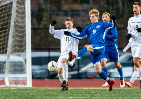 Pomperaug's Jaden Finkel-Hozer #11 and Glastonbury's Jake Calderbank #9 battle for control of the ball during a Boys Soccer Class L Semifinal game between Glastonbury and Pomperaug at Veterans Memorial Stadium at Willowbrook Park in New Britain on Wednesday. Bill Shettle Republican-American