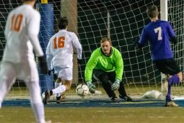 Watertown goalkeeper Hayden Beauty #00 dives out to make a save with Watertown's Kameron Pruitt #16 and Ellington's Ryan Zahner #7 looking on during a Boys Soccer Class M Semifinal game between Ellington and Watertown at Municipal Stadium in Waterbury on Wednesday. Bill Shettle Republican-American