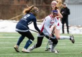 Cheshire's Sophie Cremo #5 controls the ball going past Staples' Kyle Kirby #2 during the CIAC 2018 Class L Field Hockey Championship game between Staples and Cheshire at Wethersfield High School in Wethersfield on Sunday. Staples beat Cheshire 2-0, thus winning the Class L Championship for 2018. Bill Shettle Republican-American
