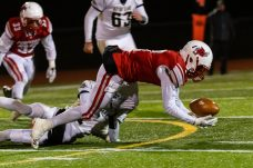 Pomperaug quarterback Troy Harrell #7 tries to recover his own fumble on a punt return during the regular season finale between Notre Dame of Fairfield and Pomperaug at Pomperaug High School in Southbury on Wednesday. Bill Shettle Republican-American