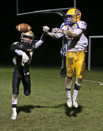 Woodland High School's Mike Farina causes an incomplete pass to Seymour High School's Tyler Ganim during the game at Woodland High School on Wednesday. Emily J. Reynolds. Republican-American