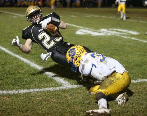 Seymour High School's Tyler Ganim tackles Woodland High School's Zachariah Kabusk during the game at Woodland High School on Wednesday. Emily J. Reynolds. Republican-American