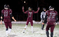 Torrington's Rangel Pascual (2) celebrates a touchdown with teammates Ora Curry (11) and Zach Sweeney (72) during their annual match--up with Watertown Wednesday at Torrington High School. Jim Shannon Republican American